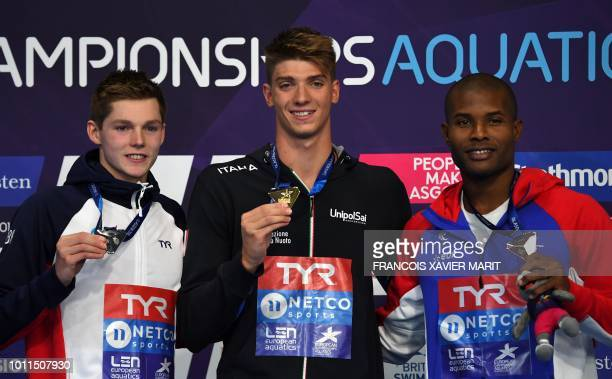 silver medalsit Britain's Duncan Scott gold medalist Italy's Alessandro Miressi and France's Mehdy Metella pose on the podium during the medal...