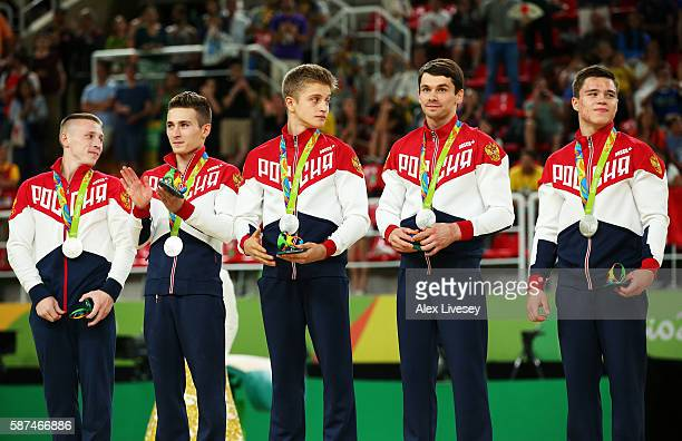 Silver medalst Russia members stand on the podium at the medal ceremony for the men's team final on Day 3 of the Rio 2016 Olympic Games at the Rio...