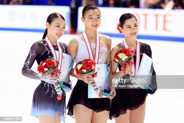 Silver medelist Rika Kihira gold medalist Kaori Sakamoto and bronze medalist Satoko Miyahara pose for photographs at the medal ceremony for the...