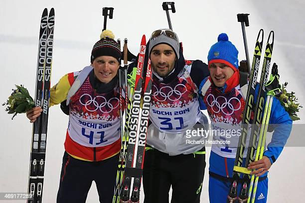 Silver medlaist Erik Lesser of Germany, gold medalist Martin Fourcade of France and bronze medalist Evgeniy Garanichev of Russia pose after the...