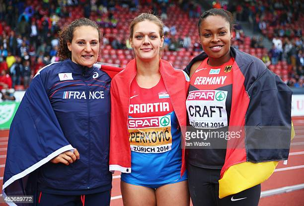 Silver medlaist Melina RobertMichon of France gold medalist Sandra Perkovic of Croatia and bronze medalist Shanice Craft of Germany celebrate after...