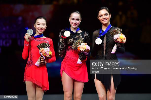 Silver medlist Elizabet Tursynbaeva of Kazakhstan gold medalist Alina Zagitova of Russia and bronze medalist Evgenia Medvedeva of Russia pose on...