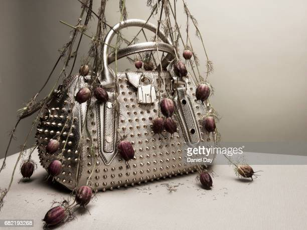 Silver metal handbag with spikes between flowers