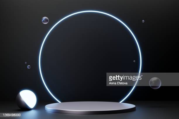 silver metallic podium on black background with neon lights. perfect for cosmetics - winners podium stock pictures, royalty-free photos & images