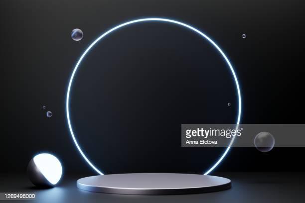 silver metallic podium on black background with neon lights. perfect for cosmetics - entrega de prêmios - fotografias e filmes do acervo