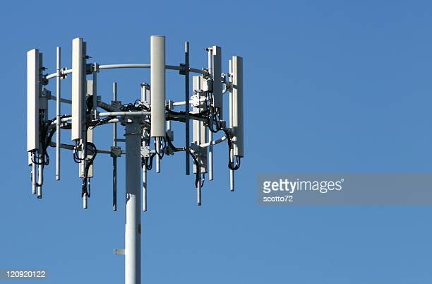 A silver mobile phone tower in the blue sky