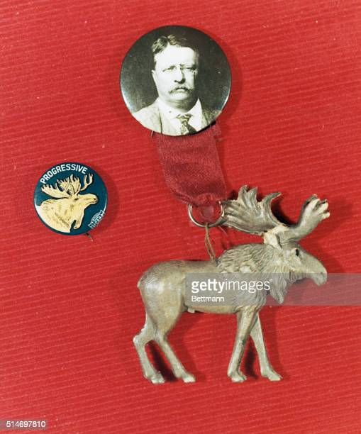 A silver moose hangs from a button with Theodore Roosevelt's portrait The moose was the symbol of the Progressive or Bull Moose Party founded by...