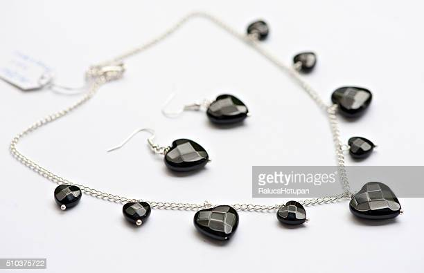 silver necklace with onix hearts