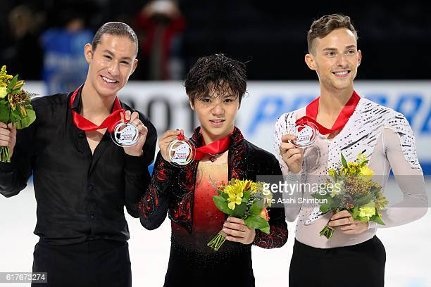 Silver nedakust Jason Brown of the United States gold medalist Shoma Uno of Japan and bronze medalist Adam Rippon of the United States pose on the...