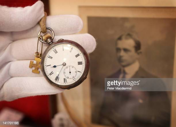 A silver open face pocket fob watch inscribed to Peter Scott in memory of his father Captain Robert Falcon scott is displayed at Bonhams auctioneers...