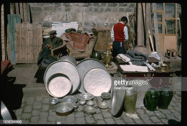 Silver Pans on Display at Street Stand
