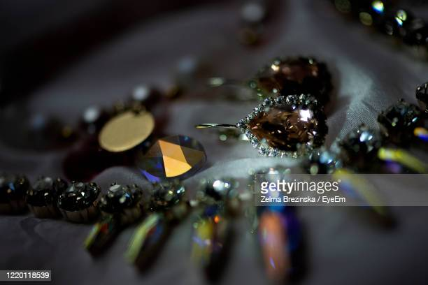 silver ,pearl and gold jewelry on the table. background of jewelry. - earring stock pictures, royalty-free photos & images