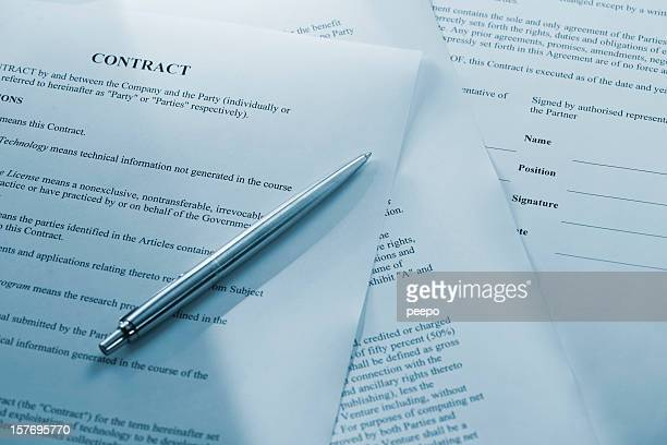 silver pen on contract document