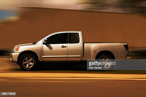 Silver Pickup Truck on Road