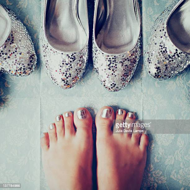 Silver plated glitter high-heels and feet