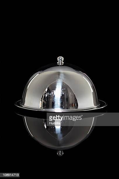 A silver platter with a lid