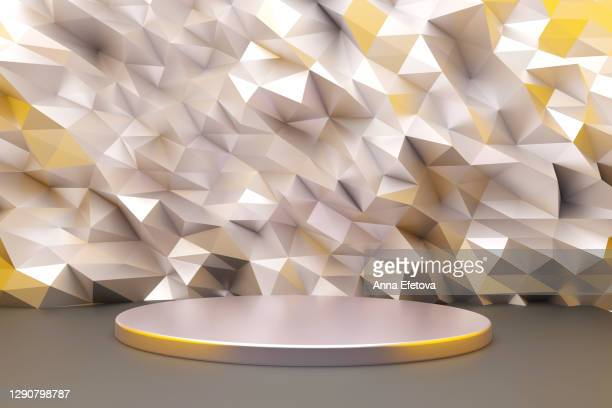 silver podium on crumpled metallic gray background with yellow color. trendy colors of the year - winners podium stockfoto's en -beelden
