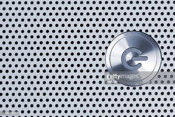 Silver power button icon on spotted background