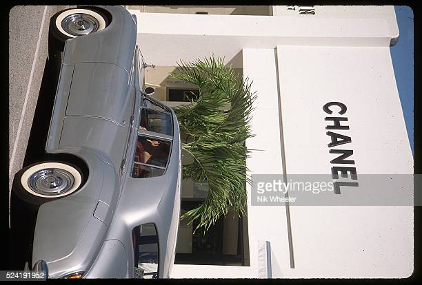 A silver Rolls Royce parks before the Chanel boutique on Worth Avenue the exclusive street for shopping in Palm Beach Florida