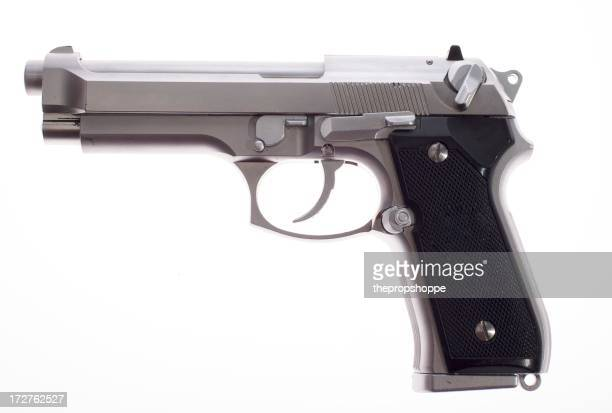 A silver semi auto handgun on white background