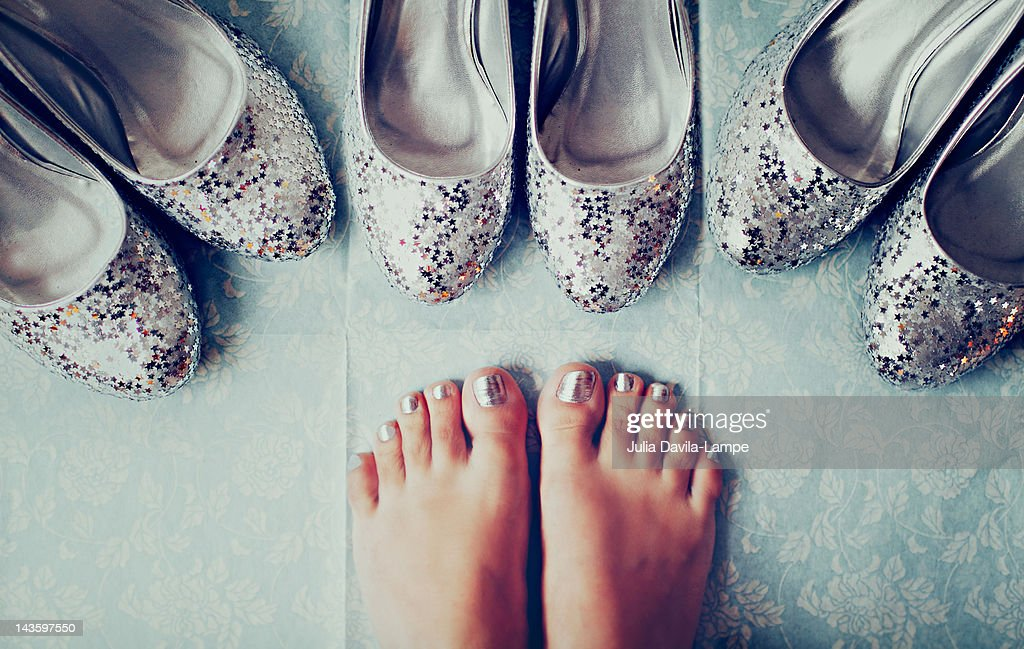 Silver shoes and feet : Stock Photo