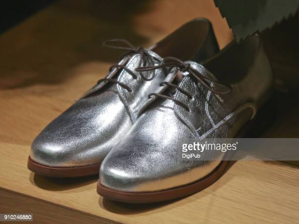 silver shoes - silver shoe stock photos and pictures