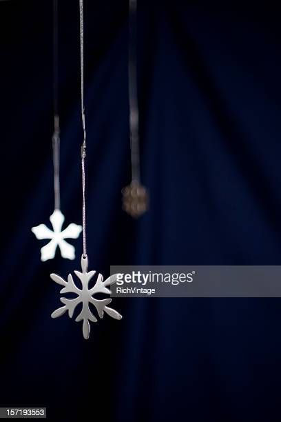silver snowflakes vertical - navy blue stock photos and pictures