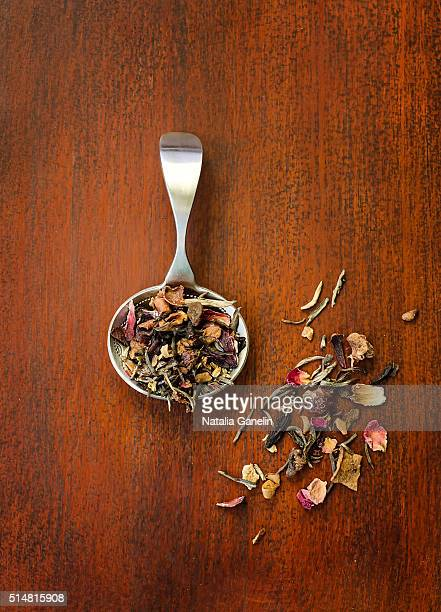 Silver spoon with loose fruit tea