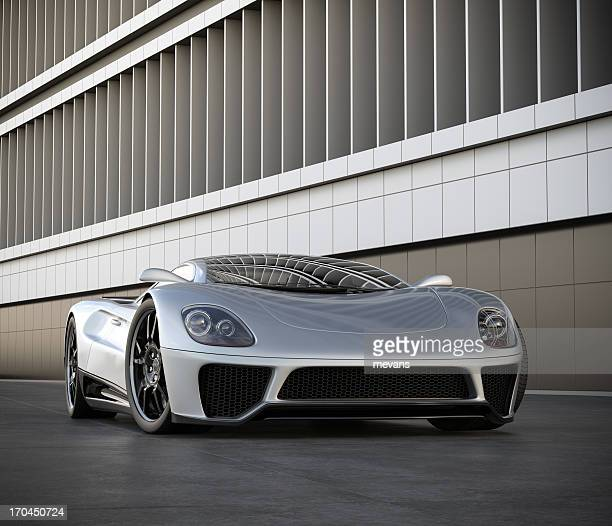 a silver sports car next to a building - status car stock pictures, royalty-free photos & images
