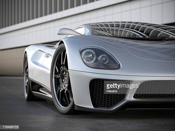 A silver sports car on black tile floor