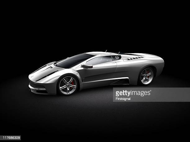 silver sports car on dark background - exoticism stock pictures, royalty-free photos & images