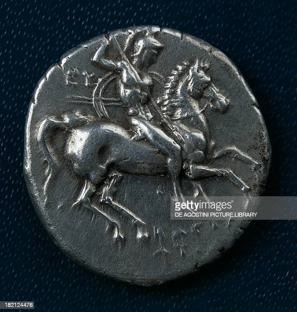Silver stater of Taranto depicting a knight with shield and spear in relief verso ca 300 BC Ancient Greek coins 4th century BC