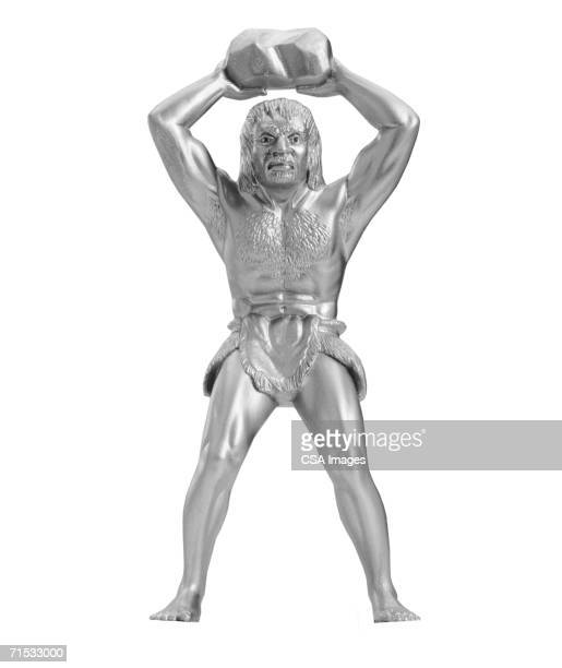silver statue of a primitive man - caveman stock pictures, royalty-free photos & images