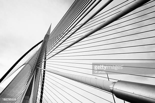 silver steel bridge - suspension bridge stock photos and pictures