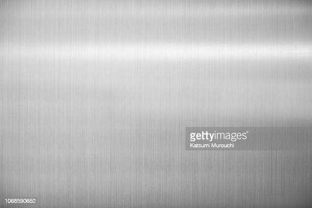 silver steel plate hairline texture background - material stock-fotos und bilder