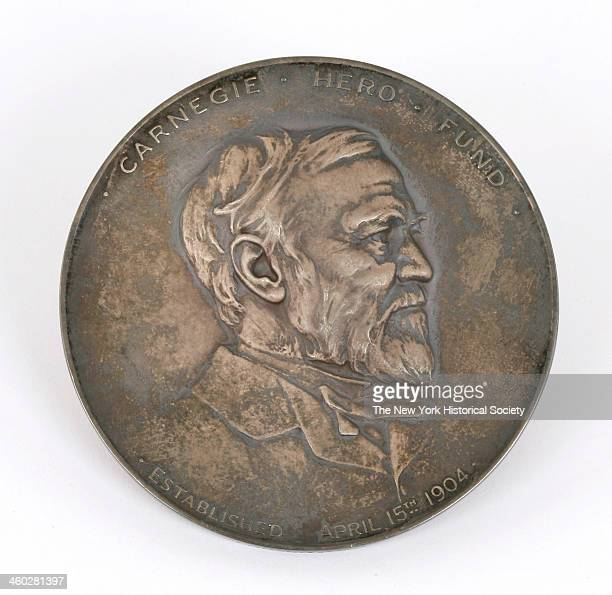 Silver struck medal with obverse showing clothed bust of Andrew Carnegie facing right with legend 'CARNEGIE HERO FUND/ESTABLISHED APRIL 15th 1904'...