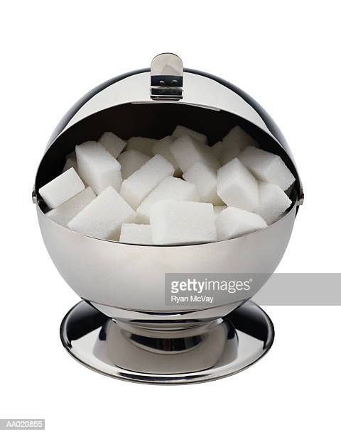 silver sugar bowl with sugar cubes - sugar bowl crockery stock photos and pictures