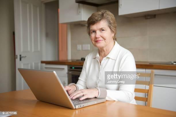 Silver surfer - Senior adult at her laptop