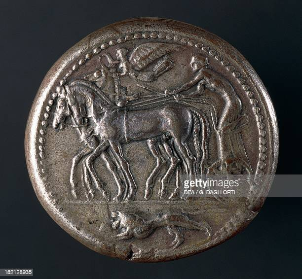 Silver Syracusan decadrachm depicting winged Victory on quadriga verso Commemorative coin minted to celebrate the victory of Gelo and the Syracusan...