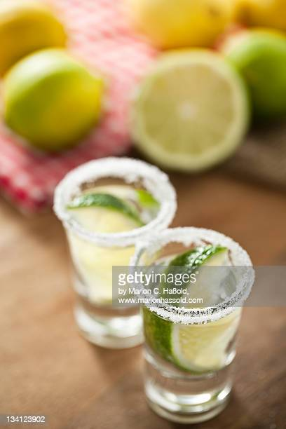 Silver Tequila, limes and salt