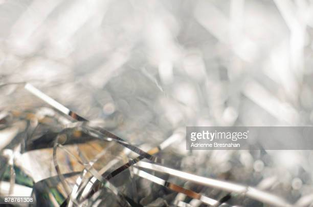 silver tinsel background close-up - tinsel stock pictures, royalty-free photos & images
