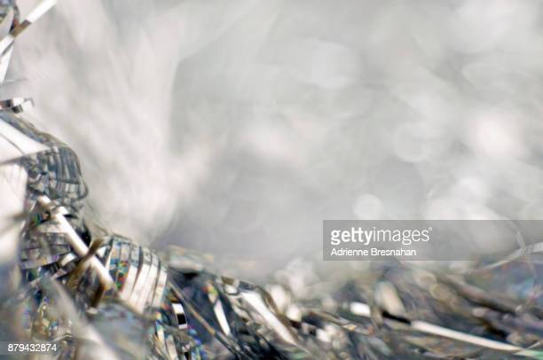 silver tinsel background - tinsel stock pictures, royalty-free photos & images