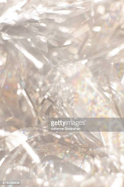 silver tinsel background with soft focus - tinsel stock pictures, royalty-free photos & images