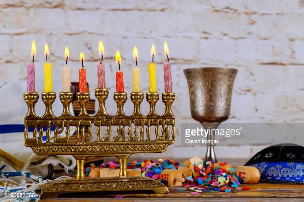 silver traditional hanukkah candles all candle lite on the menorah - hannukkah stock pictures, royalty-free photos & images