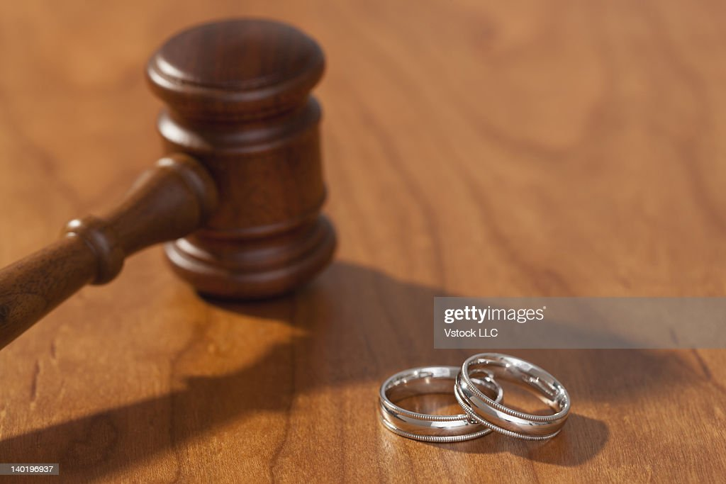 Silver wedding rings and gavel : Stock Photo