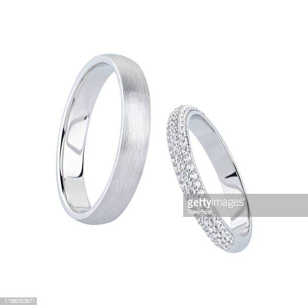 silver wedding rings with diamonds isolated on white - white gold stock pictures, royalty-free photos & images
