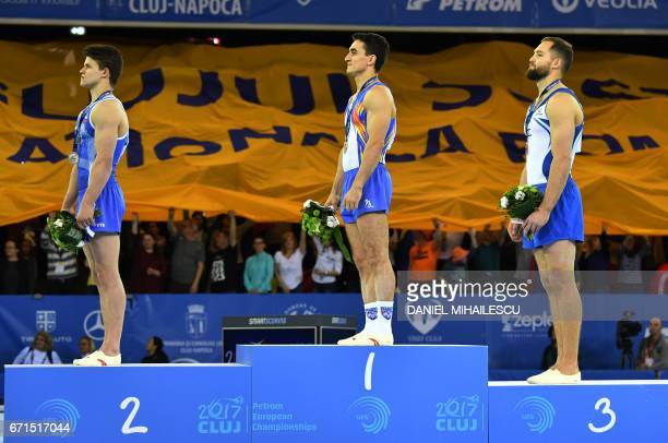 Silver winner Dmitrii Lankin of Russia Gold medalist Marian Dragulescu of Romania and Bronze medal winner Alexander Shatilov of Israel during the...