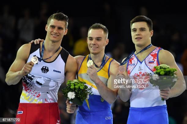 Silver winner Lukas Dauser of Germany Gold medalist Oleg Verniaev of Ukraine and Bronze winner Nikita Nagornyy of Russia during the medals ceremony...