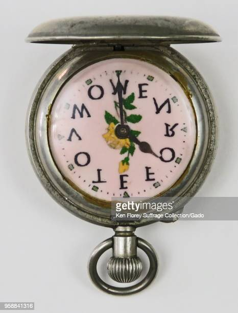"Silvercolored prosuffrage pocket watch or fob watch with the phrase 'Vote for Women "" with each letter corresponding to a numeric position and a..."