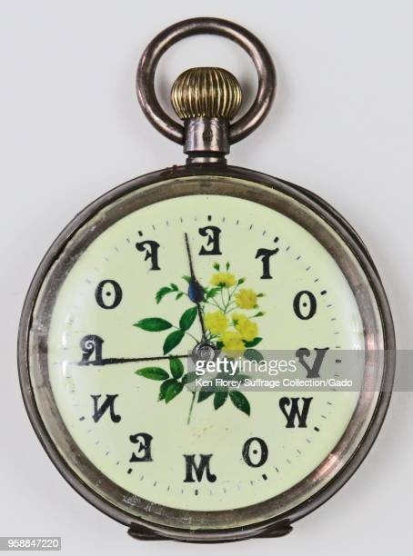 "Silvercolored prosuffrage pocket watch or fob watch with the phrase 'Vote for Women "" with each letter corresponding to a numeral and a yellow and..."